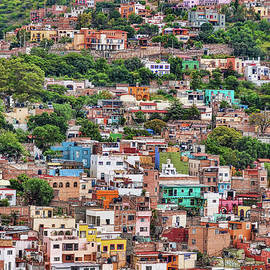 Colorful hilltop houses in Guanajuato, Mexico by Tatiana Travelways