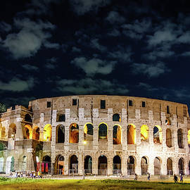 Colosseum in Rome at night by Alexey Stiop
