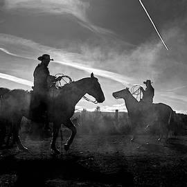 Cowboys on horses  by Julieta Belmont