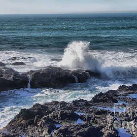 Crashing wave against rock by Jeff Swan