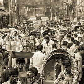 Crowd at Dhaka busy, bustling street, Bangladesh, sepia by Robert Pastryk
