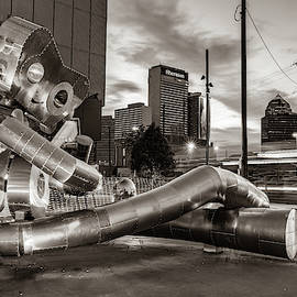 Dallas Skyline And Traveling Man Waiting On A Train - Sepia Edition by Gregory Ballos