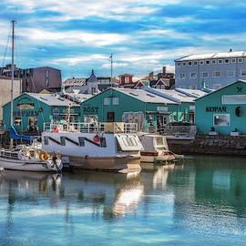 Docks At The Harbor In Reykjavik by Debra and Dave Vanderlaan