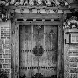 Doorway In Bukchon In Black And White by Rick Berk