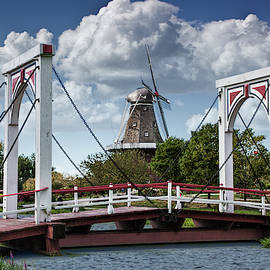 Dutch Bridge and the deZwaan Windmill at Windmill Island in Holl by Randall Nyhof