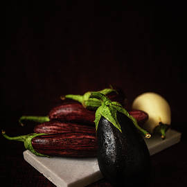Eggplants on White Marble by Cassi Moghan