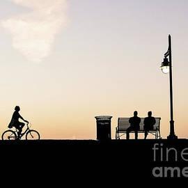 Enjoying the Evening on the Levee by Scott Pellegrin