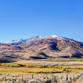 Fall Colors And Snowcap by Jim Thompson