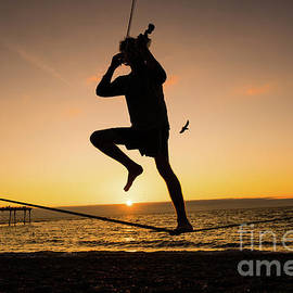 Fiddle Playing At Sunset In Aberystwyth by Keith Morris