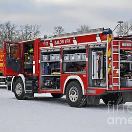 Fire trucks by Esko Lindell
