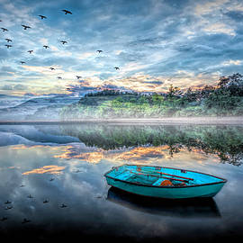 Floating Blues at Evening Light by Debra and Dave Vanderlaan