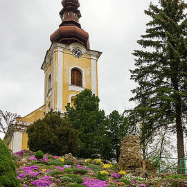 Flowers On The Hill To The Church by Les Palenik
