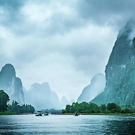 Foggy Morning On The Li River  by Kevin McClish