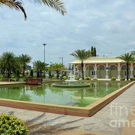 Fountain beside Pattani Central mosque and building with arches Thailand by Imran Ahmed