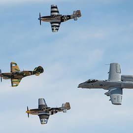 Four Aircraft Heritage Flight by Dan McManus