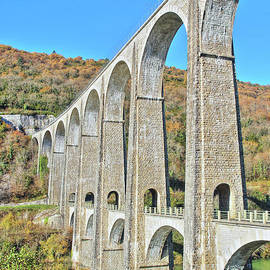French stone viaduct bridge in Rhone-Alpes region in autumn season by Gregory DUBUS