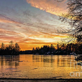 Frozen lake at sunset by Claudia M Photography