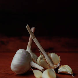 Garlic Bulbs and Cloves by Cassi Moghan