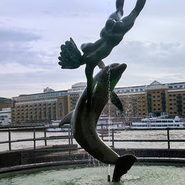 Girl With a Dolphin Fountain by Phyllis Taylor