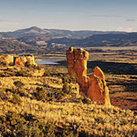 Golden Hour Panorama Of Chimney Rock And Cerro Pedernal From Ghost Ranch Abiquiu New Mexico by Silvio Ligutti