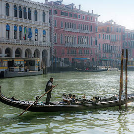 Gondolier On The Grand Canal In Venice by Wolfgang Stocker