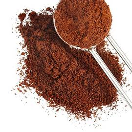 Ground Coffee Pile With Spoon Isolated by Deepblue4you