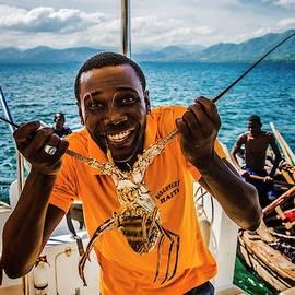Haitian Lobster Salesman by Max Huber
