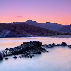 Half Moon beach. Purple sunset at the mountains by Guido Montanes Castillo