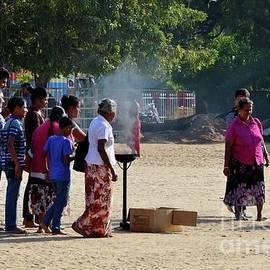 Hindu Tamil worshippers make offerings at compound of Nallur Kandaswamy temple Jaffna Sri Lanka by Imran Ahmed