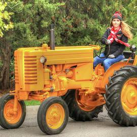 Husker Girl In Nebraska Tractor Parade by J Laughlin