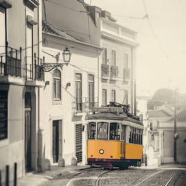 Iconic Yellow Tram 28 Lisbon Portugal by Carol Japp