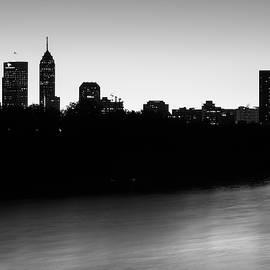 Indianapolis Skyline Silhouettes Over The White River - Monochrome by Gregory Ballos