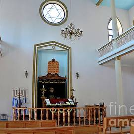Interior of Jewish synagogue with Star of David pews altar menorah hanukkah candle Batumi Georgia by Imran Ahmed