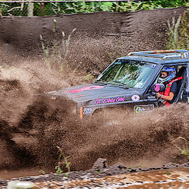 Jeep Girl Getting Muddy by Mike Martin