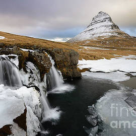 Waterfall and Kirkjufell Mountain in Winter by Tom Schwabel