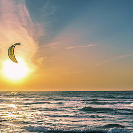 Kitesurfing At Sunset by Michael Goyberg