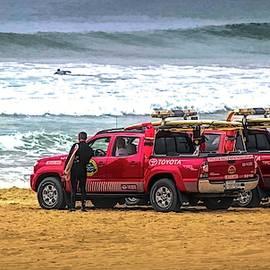 Lifeguards Huntington Beach California  by Chuck Kuhn