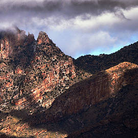 Light dances on the Catalinas by Chance Kafka