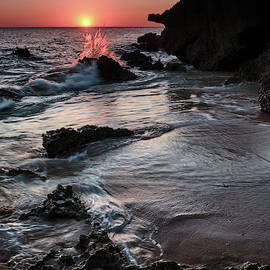 Looking at sunset. Roche reefs  by Guido Montanes Castillo