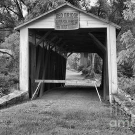 Looking Through The Red Covered Bridge Black And White by Adam Jewell