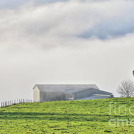 Low clouds in mountain landscape by Gregory DUBUS