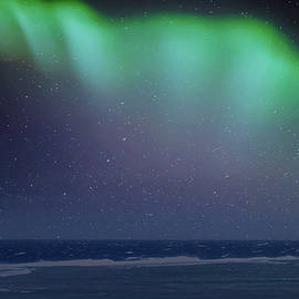 Magical Aurora Borealis Above The Ocean by Johanna Hurmerinta