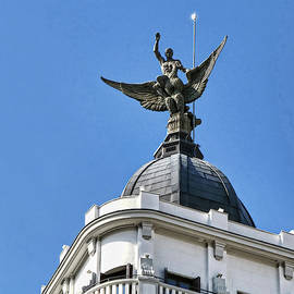 Man Riding Winged Creature - Madrid by Allen Beatty