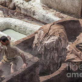 Man working at tannery in Morocco by Patricia Hofmeester