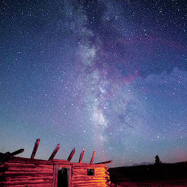 Milky Way Spilling Down On Cabin by Tim Kathka
