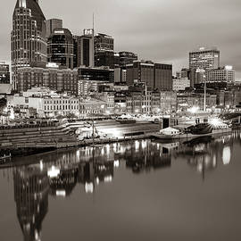 Nashville Skyline On The Cumberland River - Sepia Edition by Gregory Ballos