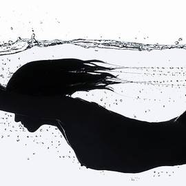 Nude Diving, Silhouette by Udo Kilian