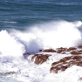 Ocean wave surging over rock by Jeff Swan
