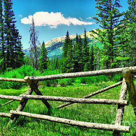 A fence foreground the mountains by Jeff Swan