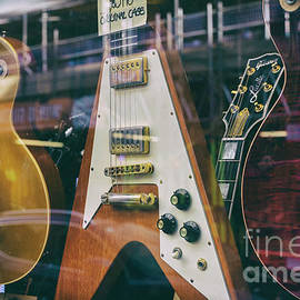 Old Guitars In A Shop Window by Tim Gainey